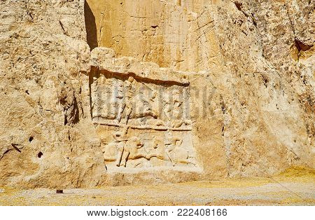 The panels with equestrian reliefs, carved in Hossein Mount, Naqsh-e Rustam Necropolis, Iran.