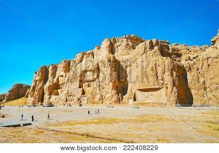 NAQSH-E RUSTAM, IRAN - OCTOBER 13, 2017: Panorama of Naqsh-e Rustam Necropolis - Hossein Mount with mausoleums on its front, on October 13 in Naqsh-e Rustam.