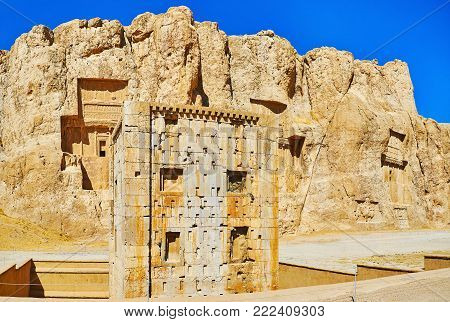 Panorama of Naqsh-e Rustam Necropolis with a view on Zoroaster tower and tombs in Hossein Mount on the background, Iran.