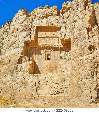 The carved in rock Mausoleum of Darius II in Naqsh-e Rustam Necropolis, from below can be seen preserved equestrian relief, Iran.