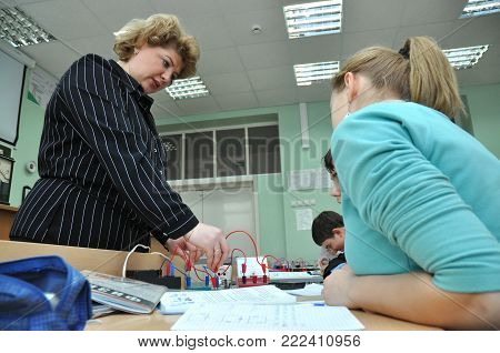 Gadjievo, Russia - January 19, 2011:  The teacher conducts laboratory work in physics in physics