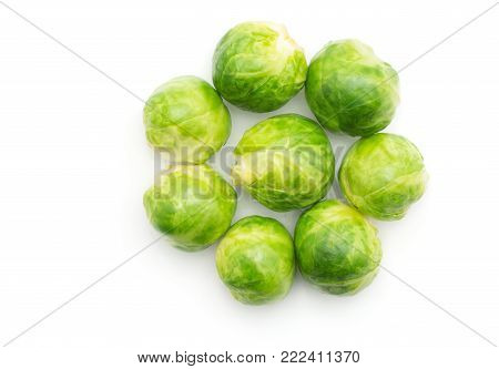 Boiled Brussels sprout heads folded like flower top view isolated on white background