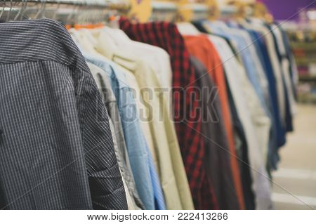 Collection of different shirts in second hand shop.