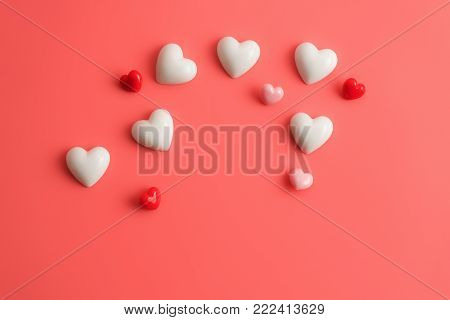 Flat view of valentines hearts and decoration on pink background with copy space. Symbol of love. Happy Valentines Day background.Saint Valentine's Day concept.
