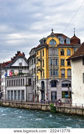 Lucerne, Switzerland - June 14, 2017: Historic city center of Lucerne and river Reuss shown at dawn