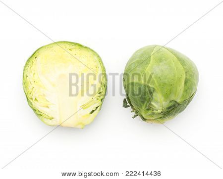 Brussels sprout one head and half top view isolated on white background