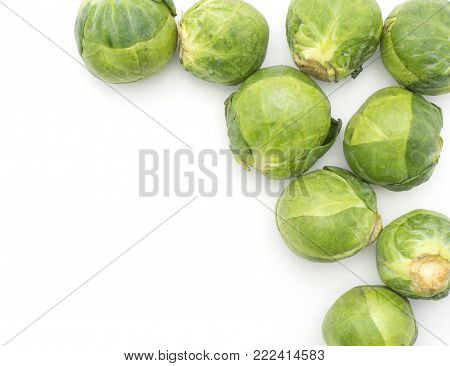 Raw Brussels sprout heads top view isolated on white background on right side