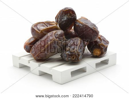 Date fruit Medjool stack on a pallet isolated on white background