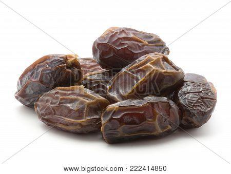 Date fruit Medjool heap isolated on white background