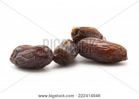 Four date fruits Medjool isolated on white background