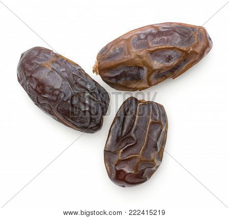 Three date fruits Medjool variety top view isolated on white background
