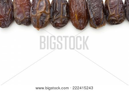 Date fruits Medjool in line top view isolated on white background