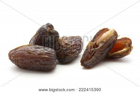 Date fruit Medjool three whole and two halves isolated on white background