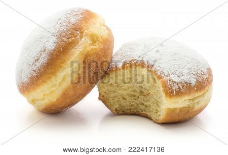 Two doughnuts (Sufganiyah) one bitten isolated on white background fresh baked with powered sugar