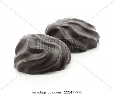 Dark chocolate-coated zefir isolated on white background two glossy