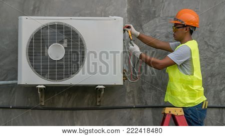 Technician Is Checking Air Conditioner