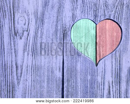 Red and green heart carved in a wooden board. Background. Postcard, valentine
