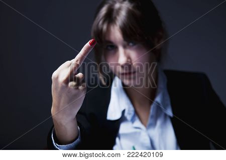 Business Woman Showing Hand Gesture Of Middle Finger Sign As Symbol Of Fury And Aggression On Workpl