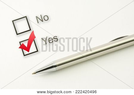 questionnaire: yes or no choice, check box with a pen on paper background closeup