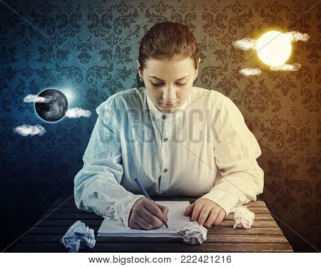 Young woman stay at the desk and writing , has sun and moon floating on either side of her head. Concept of working day and night.