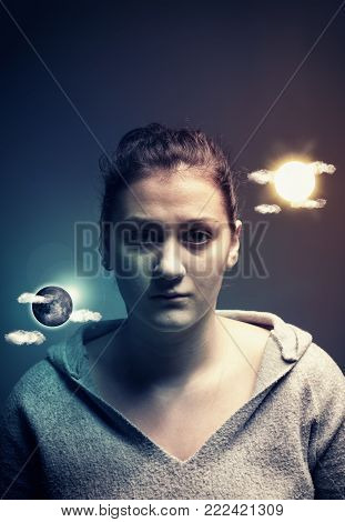 A tired looking woman has sun and moon floating on either side of her head