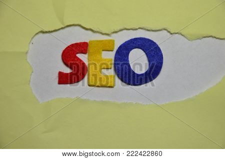 word seo on an  abstract colored backgrou nd