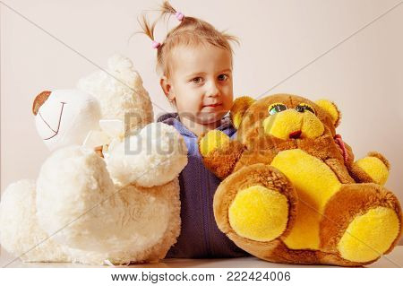Beautiful Child Girl Playing With A Teddy Bear (happy Childhood, Joy, Serenity, Role Games Concept)