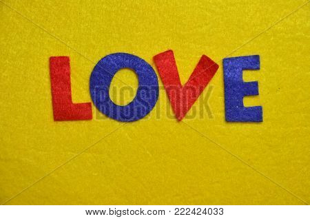 word love on an abstract yellowq background