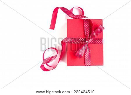 Red gift box with red dotted ribbon isolated on white background. Top view.