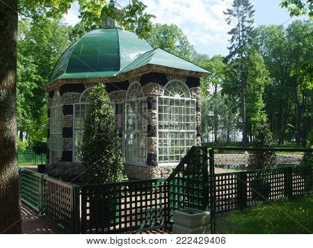 Petergof, Saint Peterburg, Russia - JUNE 12, 2013: Stone summer House cottage with green roof in the garden