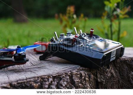 Special devices for the control of the radio controlled sports drones or radiomodel of the toy car. Entertainment for adults outdoors. Park and summer vacation.