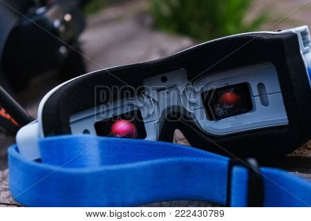 Close-up video monitors-glasses for the control of the radio controlled sports drones, the model of the car. Entertainment for adults outdoors. Park and summer vacation.