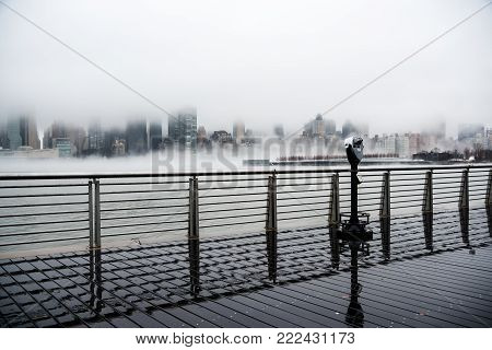 A dense fog covered New York City during the winter's day on January of 2018. View of Manhattan and Roosevelt Island.