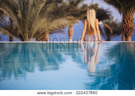 Black Silhouette Of Happy Woman On Summer Beach Holiday Relaxing In Luxury Spa Hotel In Infinity Swi