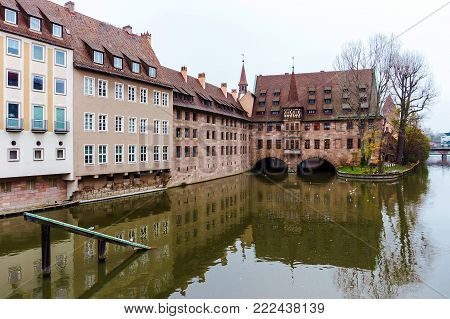 Nurnberg Landmark, Heilig-Geist-Spital or Hospice of the Holy Spirit in autumn, Nuremberg, Germany. View from the Bridge on the River Pegnitz Museum
