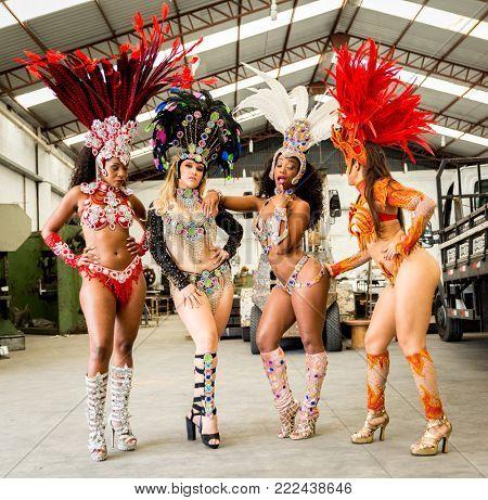 Brazilian woman wearing carnival costume in an old factory