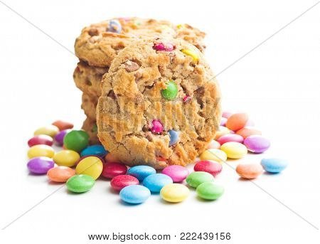 Sweet cookies with colorful candies isolated on white background.