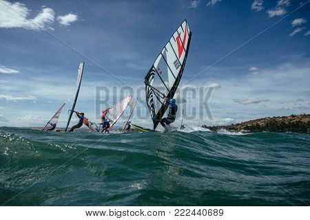 Windsurfing Competitionon january10, 2018: view of a windsurfer in the South China Sea on January 10, 2018 in Mui Ne, Vietnam