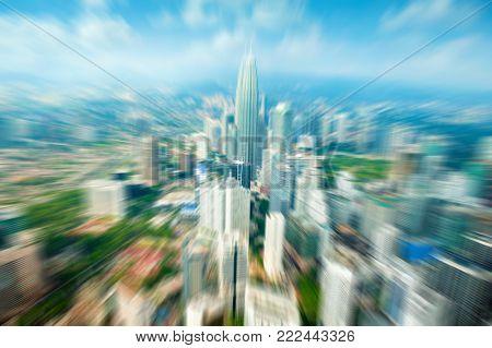 Zoom Kuala Lumpur city Malaysia, daytime blue sky.