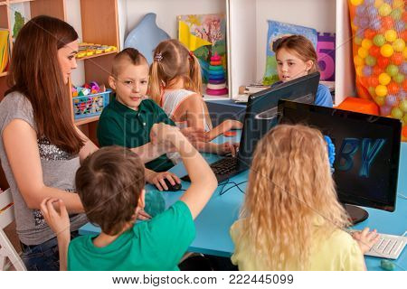 Children computer class us for education and video game. Boys and girls in children's club developing computer games. New technologies alternative to classical training. Online training.
