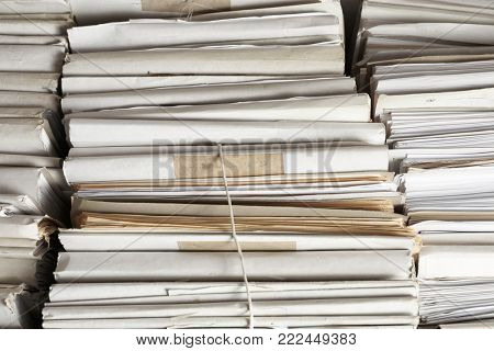 Stacks of old folders with documents in archive, closeup