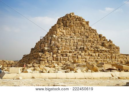 CAIRO, EGYPT - NOVEMBER 19, 2017: View of small pyramid on the Giza Plateau - one of the most famous cultural attractions in the world