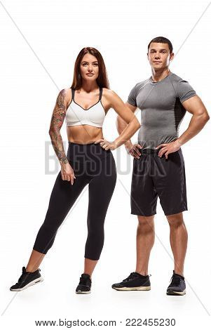 Athletic muscular man and woman after fitness exercise