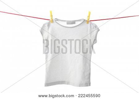 Clean t-shirt on laundry line against white background
