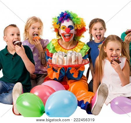 Birthday child clown playing with children who eat cake. Kid with nose bunny fingers prank. Fun of group people pose for camera sit at table white background. Eating a holiday cake. End of school year