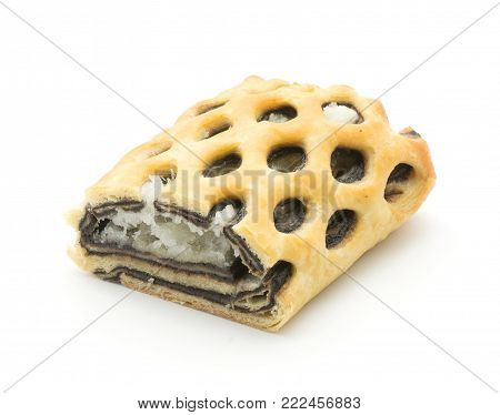 Sliced lattice bread half with coconut and chocolate mousse inside isolated on white background fresh baked