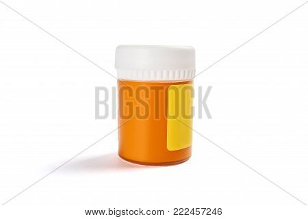 Jar of yellow food coloring isolated on white background