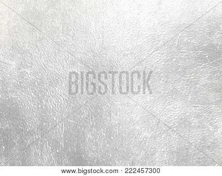 Silver foil background - abstract light grey shiny metal texture