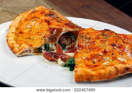 Delicious pizza calzone
