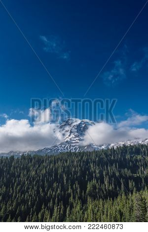 Cloudy Mount Rainier and Deep Blue Sky in summer